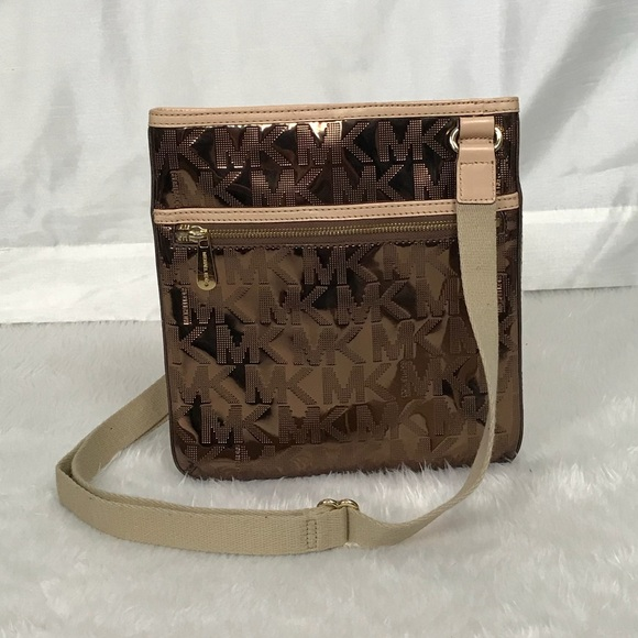 95d291559cf2 💥Michael Kors rose gold mirror metallic crossbody.  M_5b2b26003e0caadb931b6b88